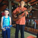 My son playing along with an entertainer at the restaraunt