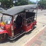 Red tuk tuk in the front of hotel. Easy to find