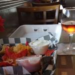 Chips with dip and a glass of wine for an appetizer.