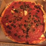 Sauce is on top of their pan-style pizza!