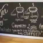 Menu offerings are featured on chalkboards.