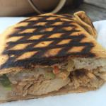The menu, a tribute to service men and women in the dining room, the Thai chicken grilled wrap,