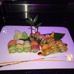 A delicious plate of specialty rolls and sashimi from Sakana Sushi