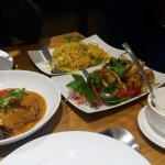 Fried fish in red curry sauce and king prawns with baby aubergine, with noodles and coconut rice