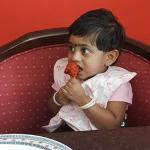 My baby enjoying chicken lollipop