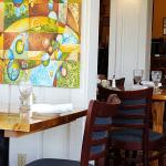 Dining room with lovely art on walls