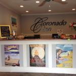 The Coronado Inn Front Desk with colorful vintage posters and welcome treats