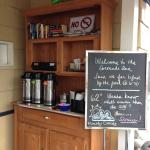 Complimentary coffee and books for guests