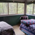 One of the Sleeping porches. Also one with two full beds