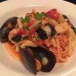 Linguini pasta with mussels, scallops, salmon, king prawns, garlic, tomato, basil, olive oil