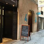 Tapas bar next door to the turquoise blue signs and entrance to reception for Brondo Architect H