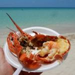 Ten bucks whole steamed lobster from a passing beach seller. So worth it!