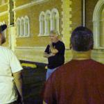 Tour host John Winterbauer tells the group the history behind one of Decatur's haunted locations