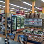 Harvest Fresh with tables, salad bar, deli, and full grocery