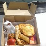 Lunch box from Naaz hotel with chicken, juice, biscuits, apple and pencake