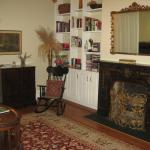 The formal living room/parlor features one of the home's seven fireplaces.
