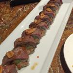 Surf and Turf roll with Kobe beef on top and lobster in the center.