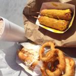 Two dip dogs, one slaw dog, onion rings and mocha shake.