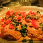 Tep's Baked Ravioli w/ ?sauce, diced tomatoes & parsley