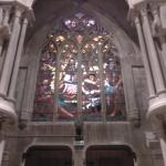 Stained glass above the main door.