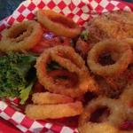 Chicken fried steak sandwich and onion rings