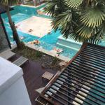 The roof was rusted and mold up the sides of jacuzzi and empty pool with smoking workers-our vie