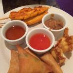 Sawatdee Plattter - Best appetizer that brings chicken satay, crab rangoons, golden shrimp & tri