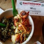 The shrimp and grits were served with yummy greens and fried onions.