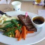 Grilled steak, red wine jus, mashed potato, honeyed carrots, baby green beans, peas and corn. $9