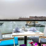 Outdoor seating with Marina view