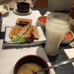Gyoza, miso soup, side dishes, calpico juice