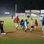 Kids running the bases after the game