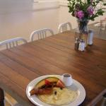 Kids pancake and fruit breakfast - note fresh-cut flowers on all tables