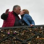 A kiss on one of the famous bridges - note the locks