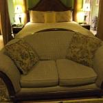 Love Seat in front of the bed
