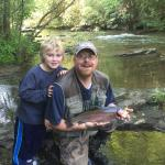 "Caught a 21"" 4 lb Rainbow Trout on fly rod . My son's first fish and our camp site at Davis Bran"