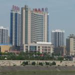 Minjiang International Hotel [brown curved building]