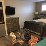 View inside Room 3 (King & Queen) - this is the queen bed; TV, small fridge, microwave, coffee p