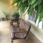 Front porch swing and lush hanging basket