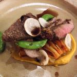 Grilled lamb loin with sweet potato gratan sugar snap peas, sweet potato puree & pearl barley ju