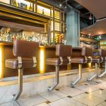 A wrap around bar, tables and booths are available.