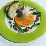 Salmon mousse. On a red bell pepper sauce, with toasted Maltese bread