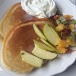 Pancakes with fresh fruits and fresh cream