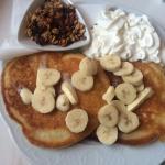 Pancakes with muesli, banana and fresh cream