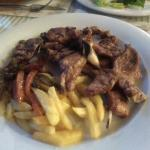 Grilled Lamb, consisted of Lamb Chops and leg of Lamb. Home made chips (not frozen) and sweet pe