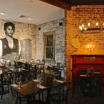 The upstairs dining room with a young Sofia Loren mural