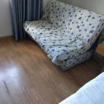 damaged floor, worn couch