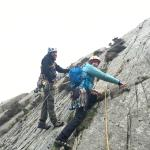 Brett guiding Emma on how to place protection while lead climbing