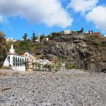 Ponta do Sol from the beach with the Estalagem Hotel on the clifftop