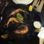 Squid Ink paella with mussels, prawns and aioli